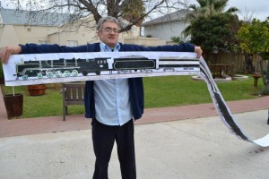 Man holding up sketches of the Rovos Train