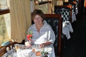 Guest enjoying breakfast on train