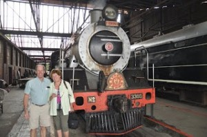 Old couple next to industrial train